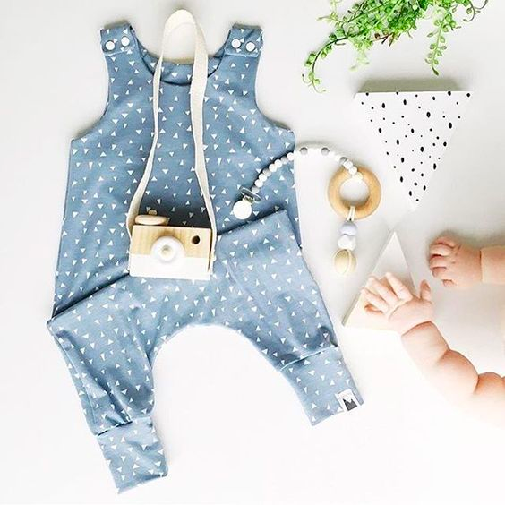 flat lay your baby clothes to take a nice photo